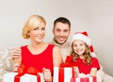Smiling family holding many gift boxes Royalty Free Stock Photo