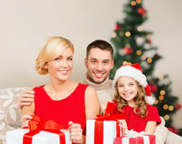 Smiling family holding many gift boxes Stock Photos