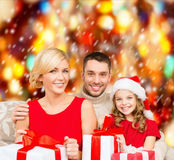 Smiling family holding many gift boxes Stock Image