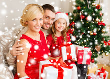 Smiling family holding many gift boxes Royalty Free Stock Images