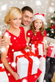 Smiling family holding many gift boxes Stock Photography