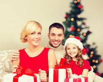 Smiling family holding many gift boxes Royalty Free Stock Photography
