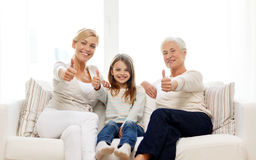 Smiling family at home Royalty Free Stock Photos