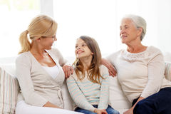 Smiling family at home Stock Images