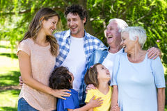 Smiling family hugging Stock Photo