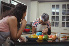 Smiling family interacting with each other in kitchen Royalty Free Stock Photo