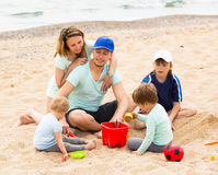 Smiling family with kids having a rest Royalty Free Stock Images