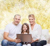 Smiling family with laptop Stock Photography