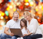 Smiling family with laptop Royalty Free Stock Image