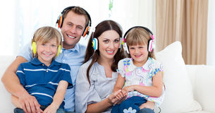Smiling Family Listening Music With Headphones Stock Image