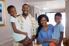 Smiling family in living room at home. Portrait of smiling family in living room at home stock images