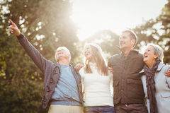 Smiling family looking away and pointing something Royalty Free Stock Image