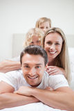 Smiling family lying on bed Royalty Free Stock Photography
