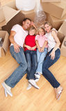 Smiling family lying on the floor Royalty Free Stock Image