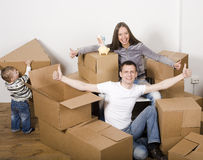 Smiling family in new house playing with boxes Stock Photography