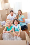 Smiling family packing boxes Royalty Free Stock Images