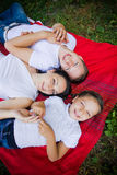 Smiling family at the park Stock Image