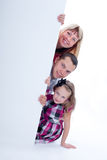 Smiling family peek out Royalty Free Stock Photos
