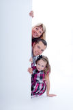 Smiling family peek out Royalty Free Stock Image