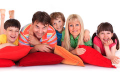 Smiling family on pillows Stock Image