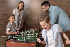 Smiling family playing foosball together Royalty Free Stock Images