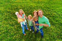 Smiling family portrait from above in park royalty free stock photography
