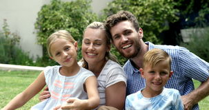 Smiling family posing for the camera stock footage