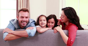Smiling family posing on sofa stock video