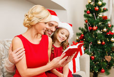 Smiling family reading book Royalty Free Stock Image