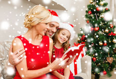 Smiling family reading book Stock Photography