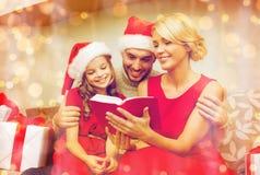 Smiling family reading book Stock Photos
