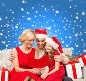Smiling family reading postcard Royalty Free Stock Photo