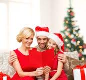 Smiling family reading postcard Stock Photo