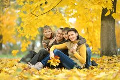 Smiling family relaxing Stock Photo