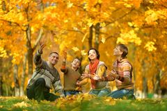 Smiling family relaxing Royalty Free Stock Photos