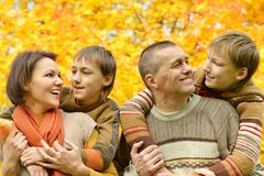 Smiling family relaxing Stock Images