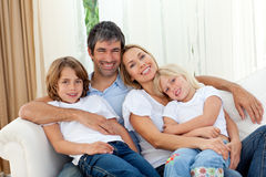 Free Smiling Family Relaxing On The Sofa Royalty Free Stock Photo - 12191395