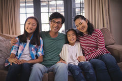 Smiling family relaxing on sofa in living room Royalty Free Stock Photos