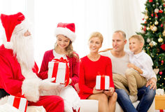 Smiling family with santa claus and gifts at home Royalty Free Stock Photo