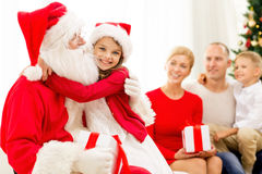 Smiling family with santa claus and gifts at home Royalty Free Stock Photos