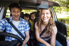 Smiling family sitting in the car. And driving Stock Images