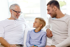Smiling family sitting on couch home Royalty Free Stock Photo