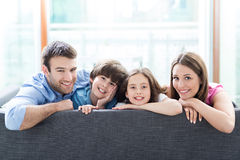 Smiling family on sofa Royalty Free Stock Photo