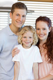 Smiling family standing in the kitchen Royalty Free Stock Images