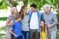 Smiling family standing Stock Photo