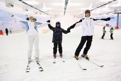 Smiling family standing on skis Royalty Free Stock Photo