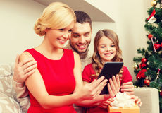 Smiling family with tablet pc Stock Photography
