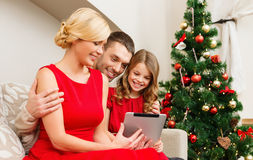Smiling family with tablet pc Stock Photo