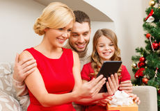 Smiling family with tablet pc Royalty Free Stock Photography