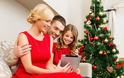 Smiling family with tablet pc Royalty Free Stock Images